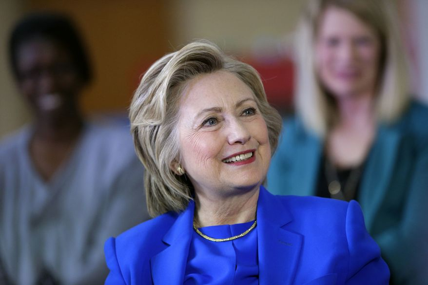 Democratic presidential candidate Hillary Clinton speaks with young parents during a roundtable discussion at the Family Care Center in Lexington, Ky., Tuesday, May 10, 2016. (AP Photo/Patrick Semansky)
