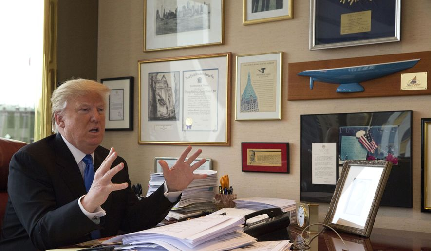 Republican presidential candidate Donald Trump gestures as he speaks during an interview with The Associated Press in his office at Trump Tower in New York, Tuesday, May 10, 2016. (AP Photo/Mary Altaffer)
