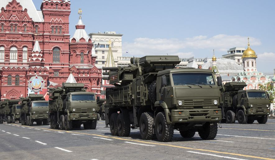 Russian air defense systems the Pantsyr-S1 drive during the Victory Day Parade on the Red Square, which commemorates the 1945 defeat of Nazi Germany in Moscow, Russia, Monday, May 9, 2016.  (AP Photo/Alexander Zemlianichenko)