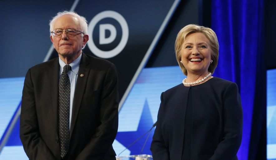 Democratic presidential candidates, Hillary Clinton and Sen. Bernie Sanders, I-Vt,  stand together before the start of the Univision, Washington Post Democratic presidential debate at Miami-Dade College, Wednesday, March 9, 2016, in Miami, Fla. (AP Photo/Wilfredo Lee) ** FILE **
