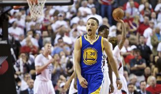 Golden State Warriors guard Stephen Curry reacts after scoring a basket against the Portland Trail Blazers during the second half of Game 4 of an NBA basketball second-round playoff series Monday, May 9, 2016, in Portland, Ore. The Warriors won 132-125. (AP Photo/Craig Mitchelldyer)