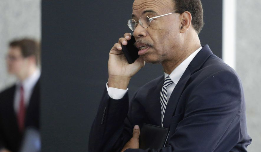 FILE - In this July 30, 2015, file photo, former Illinois U.S. Rep. Mel Reynolds talks on his cell phone as he leaves federal court in Chicago. In a handwritten filing posted Tuesday, May 10, 2016, Reynolds says he wants to plead guilty to misdemeanor federal charges of failing to file a tax return. (AP Photo/M. Spencer Green, File)