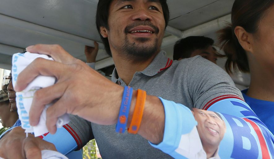 FILE - In this Friday, May 6, 2016, file photo, Congressman Manny Pacquiao, who is running for senator in the national elections, smiles from a campaign vehicle during a campaign rally in Navotas,north of Manila, Philippines. The boxing great appears to have won a seat in the Philippine Senate, according to unofficial results. Pacquiao has garnered more than 15 million votes, with about 93 percent of precincts reporting Tuesday, May 10, 2016. (AP Photo/Bullit Marquez, File)