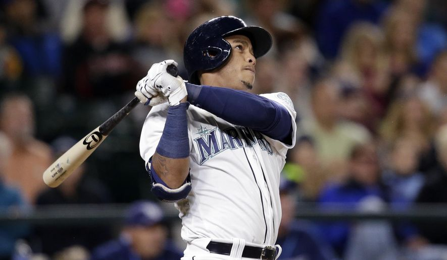 Seattle Mariners' Ketel Marte watches the path of his three-run home run against the Tampa Bay Rays in the sixth inning of a baseball game Monday, May 9, 2016, in Seattle. (AP Photo/Elaine Thompson)