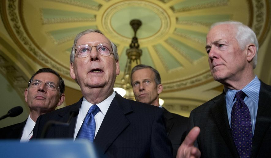 Senate Majority Leader Mitch McConnell of Ky., with, from left, Sen. John Barrasso, R-Wyo., Sen. John Thune, R-S.D., and Senate Majority Whip John Cornyn, R-Texas, speaks to reporters on Capitol Hill in Washington, Tuesday, May 10, 2016. (AP Photo/Manuel Balce Ceneta)