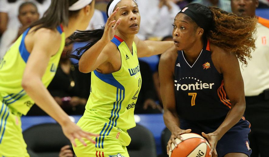 Dallas Wings center Plenette Pierson (22) defends against Connecticut Sun center Victoria Macaulay (7) in the first half of a WNBA preseason basketball game in Arlington, Texas, Sunday, May 8, 2016. The Sun won, 82-74. (Andy Jacobsohn/The Dallas Morning News via AP) MANDATORY CREDIT