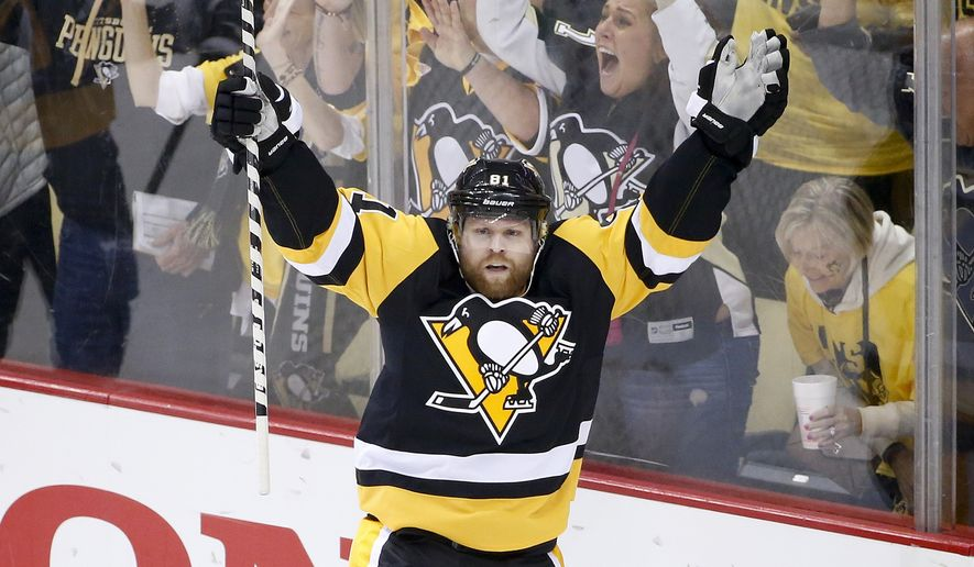 Pittsburgh Penguins' Phil Kessel (81) celebrates after scoring against the Washington Capitals during the first period of Game 6 of the NHL hockey Stanley Cup Eastern Conference semifinals in Pittsburgh, Tuesday, May 10, 2016. (AP Photo/Gene J. Puskar)