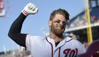 Washington Nationals' Bryce Harper pumps his fist as he takes a curtain call after he hit a grand slam during the third  inning of an baseball game against the Atlanta Braves, Thursday, April 14, 2016, in Washington. This was Harper's 100th home run of his career. (AP Photo/Nick Wass)