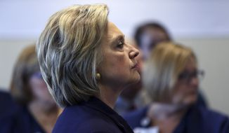 Democratic presidential candidate Hillary Clinton, listens to a question at a gathering with medical personnel at Cooper Hospital, Wednesday, May 11, 2016, in Camden, N.J. (AP Photo/Mel Evans)