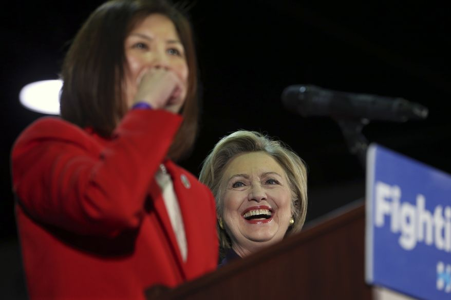 Democratic presidential candidate Hillary Clinton laughs as she is introduced by Camden County, N.J., Freeholder Susan Shin Angulo at a campaign rally, Wednesday, May 11, 2016, in Blackwood, N.J. (AP Photo/Mel Evans)