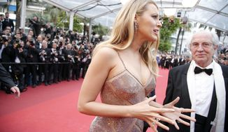 Actress Blake Lively talks as she arrives on the red carpet for the screening of the film Cafe Society and the Opening Ceremony at the 69th international film festival, Cannes, southern France, Wednesday, May 11, 2016. (AP Photo/Thibault Camus) **FILE**