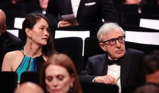 Director Woody Allen, right and his wife Soon-Yi Previn attend the Opening Ceremony at the 69th international film festival, Cannes, southern France, Wednesday, May 11, 2016. (AP Photo/Thibault Camus)