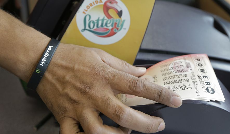 A clerk at a 7-11 store pulls Powerball tickets from a printer for a customer, Wednesday, Jan. 13, 2016, in Tampa, Fla. The jackpot for tonight's drawing is over $1 billion. (AP Photo/Chris O'Meara)