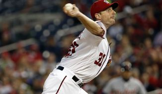 Washington Nationals starting pitcher Max Scherzer throws during the fourth inning of a baseball game against the Detroit Tigers at Nationals Park, Wednesday, May 11, 2016, in Washington. (AP Photo/Alex Brandon)