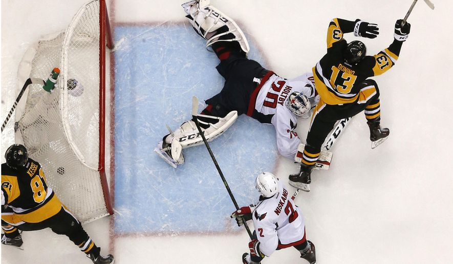 Washington Capitals goalie Braden Holtby (70) sprawls in the crease as Pittsburgh Penguins' Nick Bonino (13) begins to celebrate his overtime goal in Game 6 of an NHL hockey Stanley Cup Eastern Conference semifinal series in Pittsburgh, Tuesday, May 10, 2016. The Penguins won 4-3 and advanced to the conference finals. (AP Photo/Gene J. Puskar)