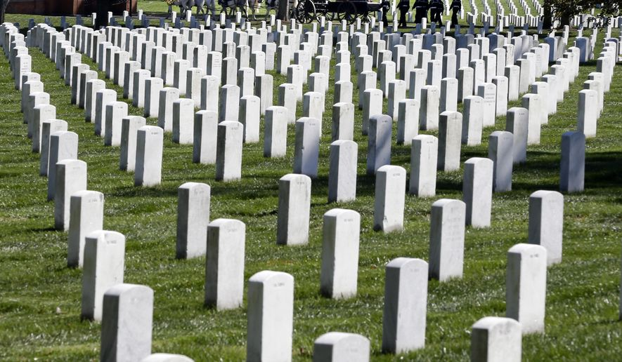 A funeral procession passes behind rows of graves at Arlington National Cemetery in Arlington, Va., Oct. 22, 2012. (AP Photo/Jacquelyn Martin, File) ** FILE **