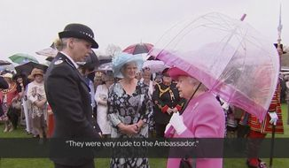 In image made from pool video, Queen Elizabeth II speaks with Metropolitan Police Commander Lucy D'Orsi in the garden of Buckingham Palace in London, Tuesday, May 10, 2016. Subtitles as appears on source video. (Image from Pool Video via AP Video)