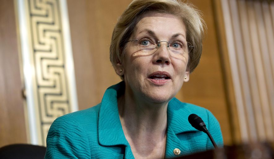 "In this photo taken Oct. 6, 2015, Sen. Elizabeth Warren, D-Mass. speaks on Capitol Hill in Washington. Warren has taken to Twitter again to bash Donald Trump, the latest in a series of Internet ""tweetstorms"" calling Trump on the carpet for his treatment of women and his insults toward her. (AP Photo/Jacquelyn Martin)"