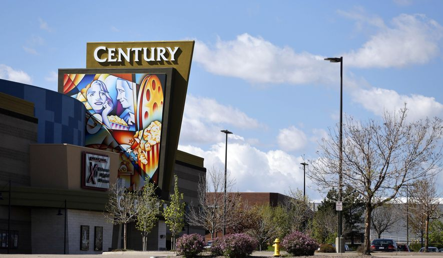 A colorful sign decorates the entrance of the Cinemark Century 16 movie theater in Aurora, Colo., on Wednesday, May 11, 2016. During the May 10, 2016 start of a civil trial over whether Cinemark should have foreseen the 2012 deadly shooting attack here, an attorney for the cinema chain argued that the gunman was so determined that no security measures could have stopped him. (AP Photo/Brennan Linsley)