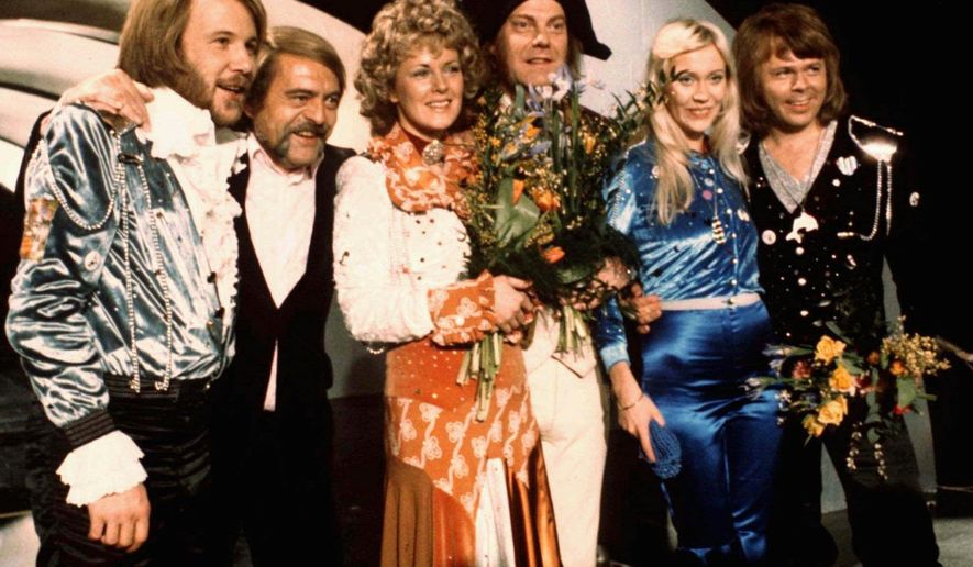 "FILE - In this April 6, 1974 file photo, members of Swedish group ABBA and close associates celebrate the victory of their song ""Waterloo"" in the Eurovision Song Contest in Brighton, England. The four members of ABBA, Benny Andersson, left, Annifrid Lyngstad, third left, Agnetha Faltskog, second right,  and Bjorn Ulvaeus, right, , second right, were the most successful winners of the Eurovision Song Contest, enjoying unprecedented success after their victory. The final of this year's competition takes place on Saturday, May 14 in the Swedish capital Stockholm. (AP Photo/File)"