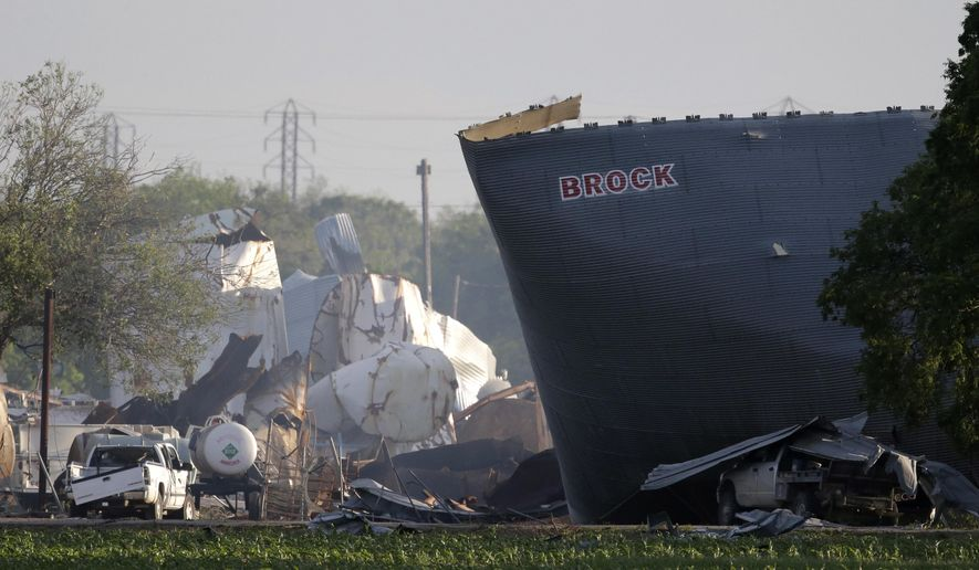In this April 18, 2013, file photo, mangled debris of the West Fertilizer Co. plant are seen, a day after an explosion leveled the plant in West, Texas. Federal authorities announced Wednesday, May 11, 2016, that the fire that caused the deadly explosion in 2013 was a criminal act. The explosion killed 15 people, injured hundreds and left part of the small town in ruins.  (AP Photo/Charlie Riedel, File)