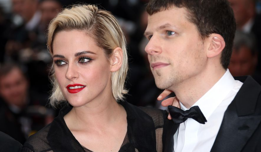 Actress Kristen Stewart, left and actor Jesse Eisenberg arrive on the red carpet for the screening of the film Cafe Society and the Opening Ceremony at the 69th international film festival, Cannes, southern France, Wednesday, May 11, 2016. (AP Photo/Joel Ryan)