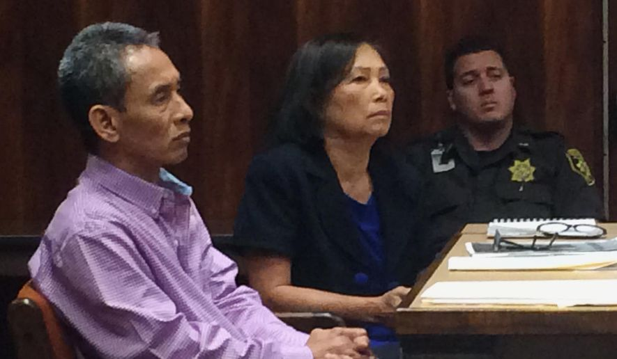 Defendant Anh Bui, left, and court interpreter Thu-Huong Crumpton, center, listen to testimony during Bui's first-degree assault trial at Circuit Court in Honolulu on Wednesday, May 11, 2016. A national report ranks Hawaii's state court system No. 1 in the country for providing support to those with limited English proficiency. (AP Photo/Audrey McAvoy)