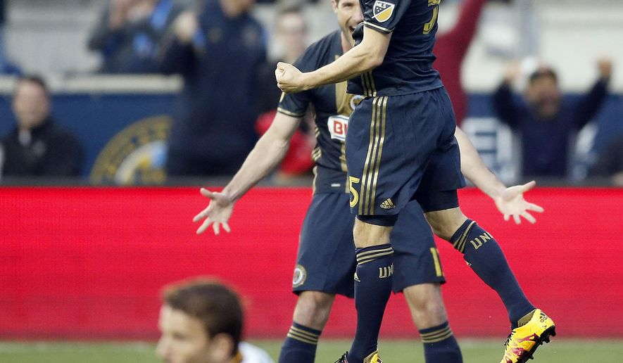Philadelphia Union midfielder Vincent Nogueira (5) celebrates his first-half goal with forward Chris Pontius (13) with Los Angeles Galaxy forward Mike Magee (18) on the grass during an MLS soccer match Wednesday, May 11, 2016, in Chester, Pa. (Yong Kim/The Philadelphia Inquirer via AP)