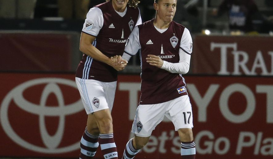 Colorado Rapids defender Marc Burch, left, congratulates midfielder Dillon Serna after he scored a goal against Sporting Kansas City in the second half of an MLS soccer game Wednesday, May 11, 2016, in Commerce City, Colo. Colorado won 1-0. (AP Photo/David Zalubowski)