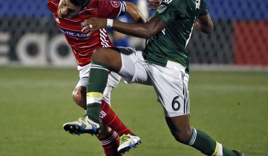 FC Dallas Mauro Diaz (10) hits a header against Portland Timbers Darlington Nagbe (6) during the the first half of a MLS soccer game, Wednesday, May 11, 2016 in Frisco, Texas. (Nathan Hunsinger/The Dallas Morning News via AP) MANDATORY CREDIT; MAGS OUT; TV OUT; INTERNET USE BY AP MEMBERS ONLY; NO SALES