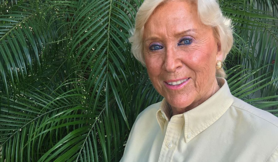 In this Tuesday, May 10, 2016, photo, Renata Senter poses at her home in Zephyrhills, Fla. Senter recalls her experience as a WWII refugee, and how she received one of the first CARE packages as a 7-year-old. Now, Senter is helping CARE International with Syrian refugees. (AP Photo/Tamara Lush)