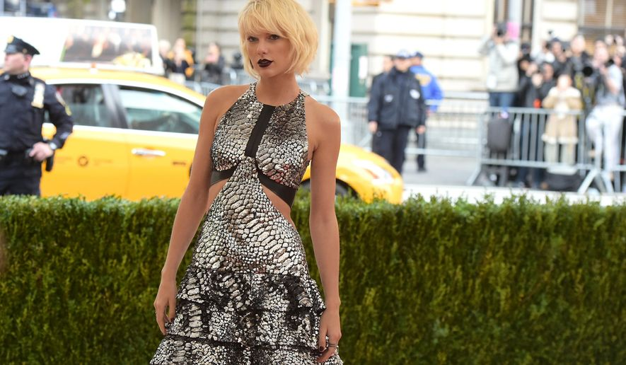 In this Monday, May 2, 2016 photo, Taylor Swift arrives at The Metropolitan Museum of Art Costume Institute Benefit Gala, celebrating the opening of 'Manus x Machina: Fashion in an Age of Technology' in New York. (Photo by Charles Sykes/Invision/AP, File) **FILE**
