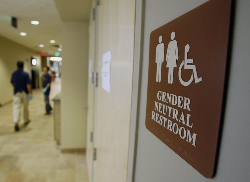 A sign marks the entrance to a gender-neutral restroom at the University of Vermont in Burlington, Vt. (Associated Press) **FILE**