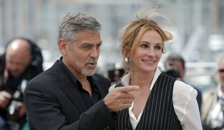 Actor George Clooney, left and actress Julia Roberts pose for photographers, during a photo call for the film Money Monster at the 69th international film festival, Cannes, southern France, Thursday, May 12, 2016. (AP Photo/Thibault Camus)