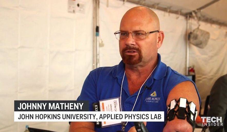 "Johnny Matheny demonstrates the Pentagon's Modular Prosthetic Limb"" at the DARPA Technology Expo in Washington, D.C. (Tech Insider video screenshot)"