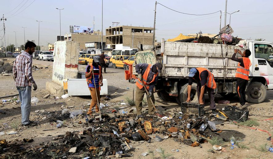 Municipality workers clean up debris a day after a car bomb explosion in Baghdad, Iraq, Thursday, May 12, 2016. In the deadliest violence in Baghdad this year, three car bombs claimed by the Islamic State group killed and wounded dozens of civilians across the Iraqi capital Wednesday, demonstrating the extremists' ability to mount significant attacks despite major battlefield losses. (AP Photo/Karim Kadim)