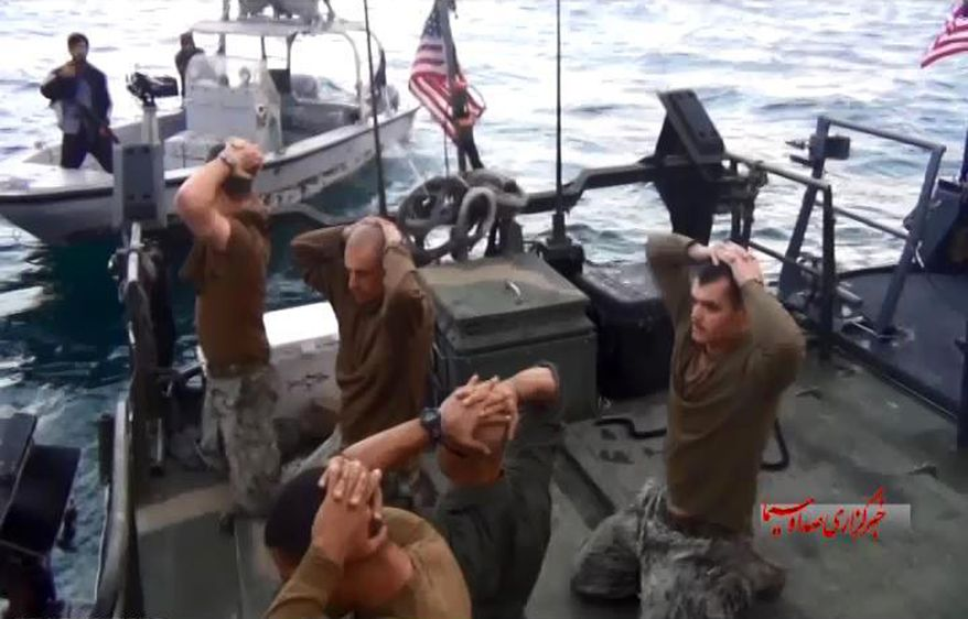 This frame grab from video taken on January 12, 2016, by the Iranian state-run IRIB News Agency shows the detention of U.S. Navy sailors by the Iranian Revolutionary Guards in the Persian Gulf. (IRIB News Agency via Associated Press) ** FILE **