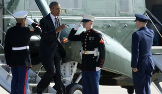 President Obama returns a salute as he is met in the tarmac by the 11th Wing and Joint Base Andrews Commander Col. William Knight, right, as he switched from the Marine One helicopter to Air Force One at Andrews Air Force Base, Md., on Aug. 22, 2013. (Associated Press)