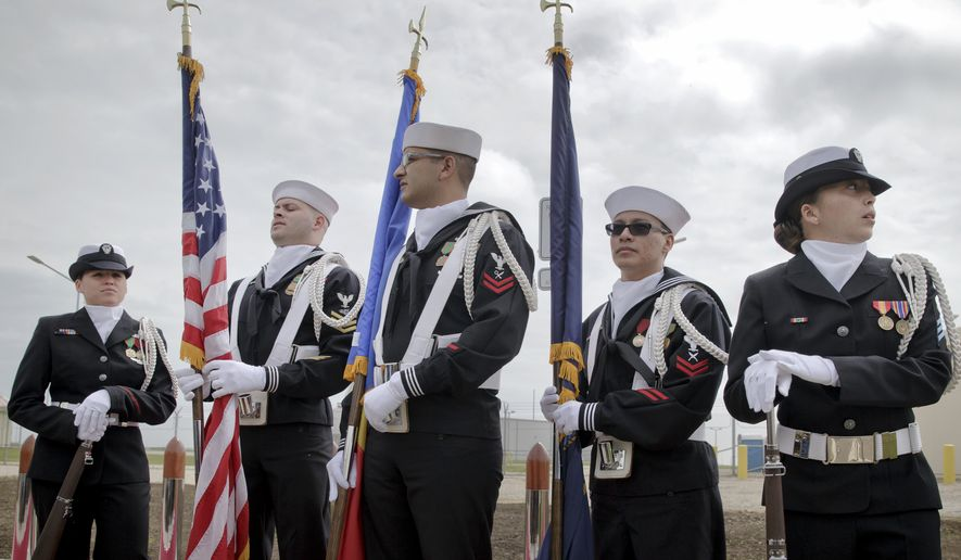 US Navy flag bearers stand in Deveselu, before an opening ceremony attended by U.S., NATO and Romanian officials at a base, originally established by the Soviet Union, in Deveselu, Southern Romania, Thursday, May 12, 2016. A U.S missile defense site in Romania aimed at protecting Europe from ballistic missile threats became operational Thursday, angering Russia which opposes having the advanced military system in its former area of influence.(AP Photo/Vadim Ghirda)