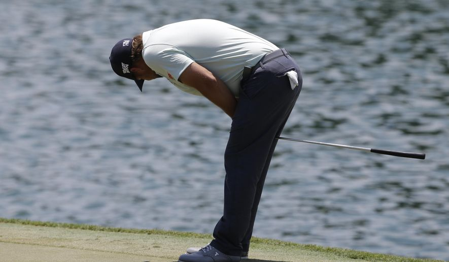Ryan Moore looks away after missing a birdie putt on the 18th green during the first round of The Players Championship golf tournament Thursday, May 12, 2016, in Ponte Vedra Beach, Fla. (AP Photo/Chris O'Meara)