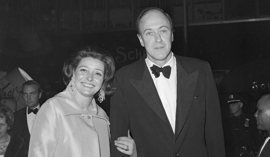 """In a Dec. 10,1968 file photo, actress Patricia Neal and her husband, writer Roald Dahl arrive for the premiere of """"The Subject Was Roses,"""" in New York. To mark the September 2016 centennial of Dahl's birth, tributes will range from a """"Traveling Trivia Tour"""" to a re-release of the 1971 film """"Willy Wonka & the Chocolate Factory,"""" starring Gene Wilder. New editions of """"James and the Giant Peach,"""" """"The Witches"""" and other classics are being published, along with the """"Oxford Roald Dahl Dictionary."""" Steven Spielberg's adaptation of """"The BFG,"""" starring Mark Rylance, will show this month at the Cannes Film Festival and will open in theaters in July.  (AP Photo/Dave Pickoff, File)"""