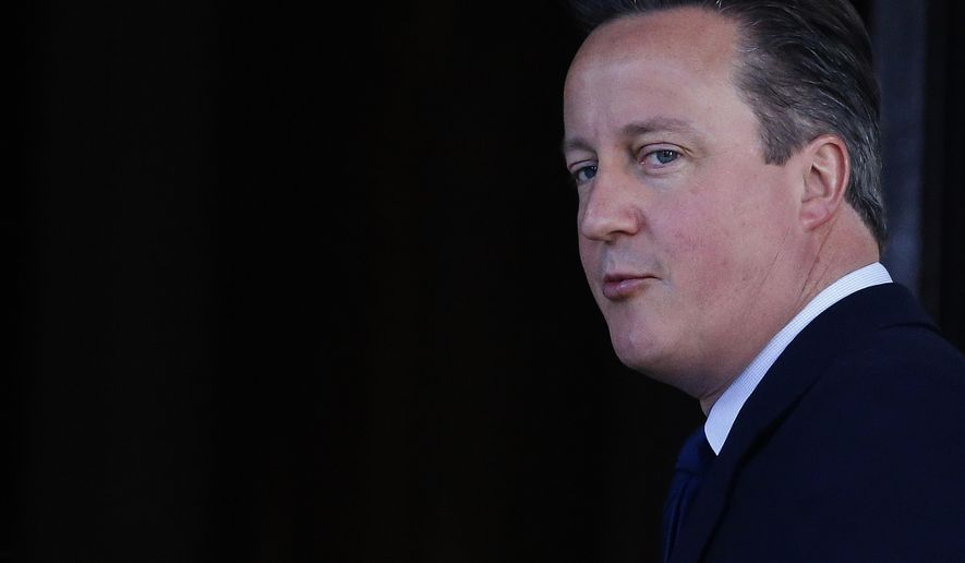Britain's Prime Minister David Cameron arrives for the Anti-Corruption Summit in London, Thursday, May 12, 2016. (AP Photo/Frank Augstein)