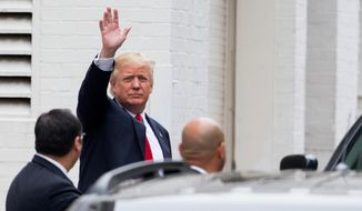 Republican presidential candidate Donald Trump waves as he arrives for a meeting with House Speaker Paul Ryan of Wis., at the Republican National Committee Headquarters on Capitol Hill in Washington, Thursday, May 12, 2016. (AP Photo/Andrew Harnik)