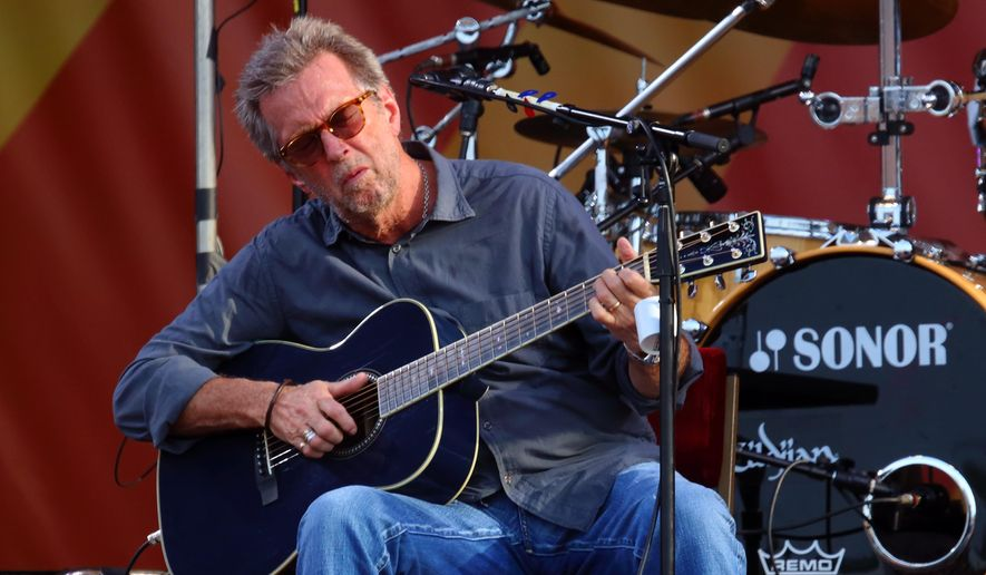 In this April 27, 2014 file photo, Eric Clapton performs at the 2014 New Orleans Jazz Heritage Festival at Fair Grounds Race Course in New Orleans. (Photo by John Davisson/Invision/AP)
