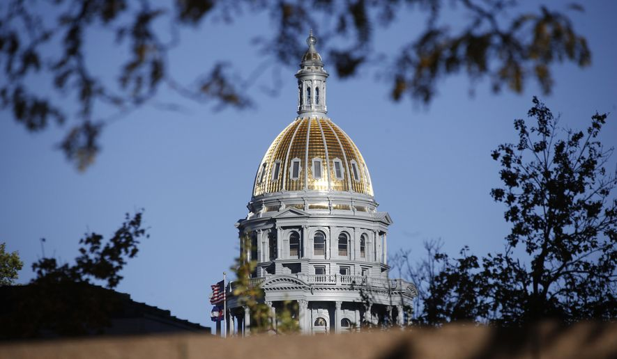 FILE - In this Nov. 3, 2015, file photo, the gold-covered dome on the State Capitol shines in the late afternoon sun in downtown Denver. A politically divided legislature, which ends its session Wednesday, May 11, 2016, in an election year to boot has proven to be a recipe for Colorado lawmakers to do just short of nothing about the state's most urgent priorities: a scarcity of affordable housing and near-stagnant funding for underfunded K-12 schools, roads and higher education. (AP Photo/David Zalubowski, file)