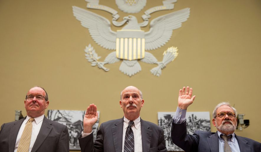 Washington, D.C. City Council Chairman Phil Mendelson, center, flanked by former Greenstein Delorme and Luchs partner Jacques DePuy, left, and former District of Columbia Attorney General Irvin Nathan, right, are sworn in on Capitol Hill in Washington, Thursday, May 12, 2016, prior to testifying before the House Government Operation subcommittee hearing on whether the District of Columbia government truly has the power to spend local tax dollars without approval by Congress. (AP Photo/Andrew Harnik)