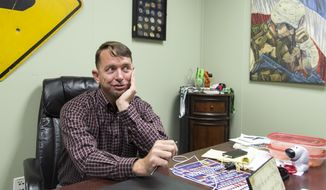 In this May 7, 2016 photo, Mike Allen sits in his office in Victoria, Texas. Allen served in the army for 20 years and now works as a volunteer coordinator for the Military Veteran Peer Network. He works to connect veterans with services they are entitled to. (Rugile Kaladyte/The Victoria Advocate via AP) MANDATORY CREDIT