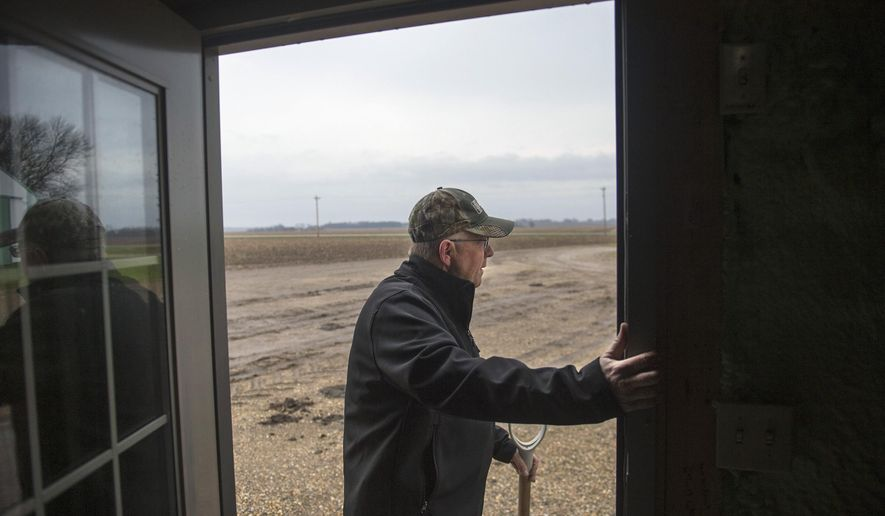 ADVANCE FOR USE SATURDAY, MAY 14 AND THEREAFTER - In this April 6, 2016, photo, farmer Russell Jackson checks the skies to determine the day's activities on his Stark County farm near Wyoming, Ill. Jackson has known nothing but farming for 40 years of his 59-year-old life. The farmland, which is nearing 120 years old, stretches across 2,750 acres over Marshall and Stark counties. (David Zalaznik/Journal Star via AP) MANDATORY CREDIT