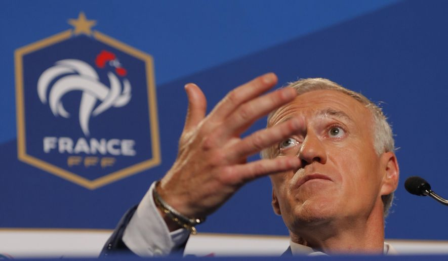 France's soccer head coach Didier Deschamps answers a question during the press conference announcing the French squad for the UEFA Euro 2016 Cup soccer after the evening broadcast news at the studios of French TV channel TF1 in Boulogne-Billancourt, near Paris, France, Monday, May 12, 2016. (AP Photo/Francois Mori)