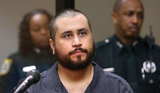 In this Tuesday, Nov. 19,  2013, file photo, George Zimmerman, acquitted in the high-profile killing of unarmed black teenager Trayvon Martin, listens in court, in Sanford, Fla., during his hearing. (AP Photo/Orlando Sentinel, Joe Burbank, Pool, File)